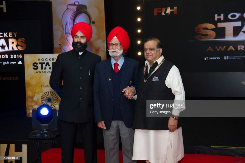 Dr Narinder Dhruv Batra [L] President of The International Hockey Federation and Balbir Singh [C] Three Time Olympic Gold Medalist pose for a picture.