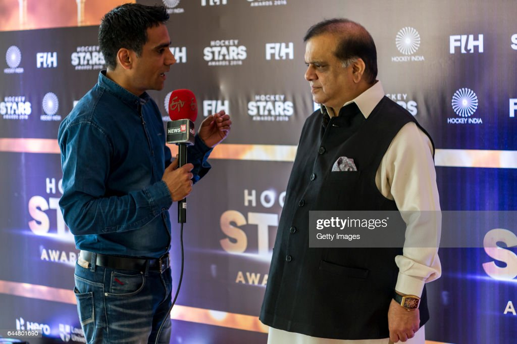 Dr Narinder Dhruv Batra President of The International Hockey Federation [R] gives an interview during the FIH Hockey Stars Awards 2016 at Lalit...