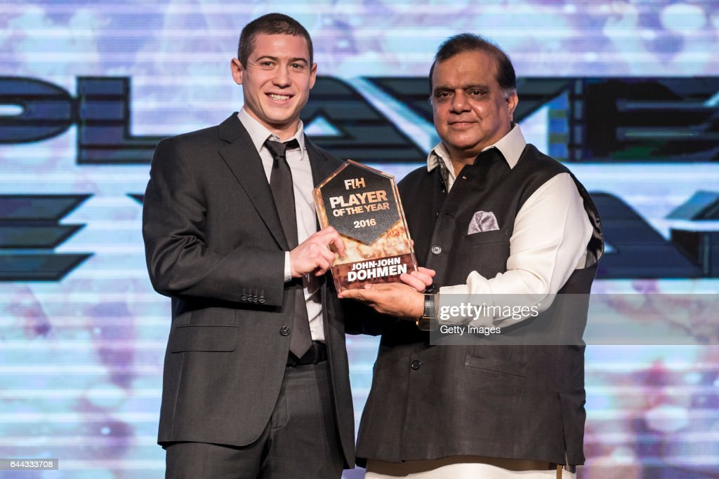 Dr Narinder Dhruv Batra [R] President of The International Hockey Federation presents the FIH Male Player of the Year award to JohnJohn Dohmen [R] of.
