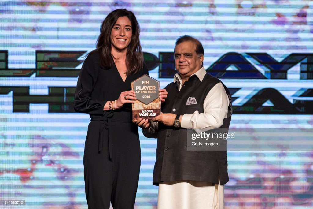 Dr Narinder Dhruv Batra [R] President of The International Hockey Federation presents the FIH Female Player of the Year award to Naomi Van As [L] of..