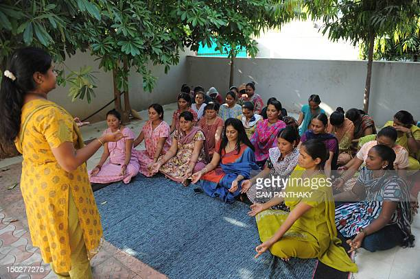 Dr Nayna Patel a pioneer of reproductive surrogacy in India participates in a yoga session with surrogate mothers at a 'surrogate mothers' home in...