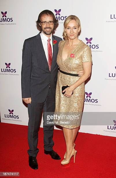 Dr Neil Murray and JK Rowling attend the Lumos fundraising event hosted by JK Rowling at The Warner Bros Harry Potter Tour on November 9 2013 in...