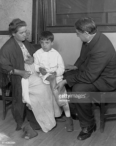 Dr Nichols of the health department examines a young boy during the infantile paralysis epidemic of 1916