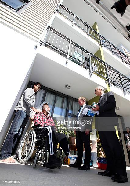 Dr Nick Smith Minister of Housing and Glen Sowry Housing New Zealand CEO talk with residents Isuf Kadir and Moidin Kadir outside their home at the...