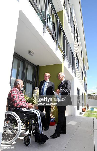 Dr Nick Smith Minister of Housing and Glen Sowry Housing New Zealand CEO talk with resident Moidin Kadir outside his home at the opening of Housing...