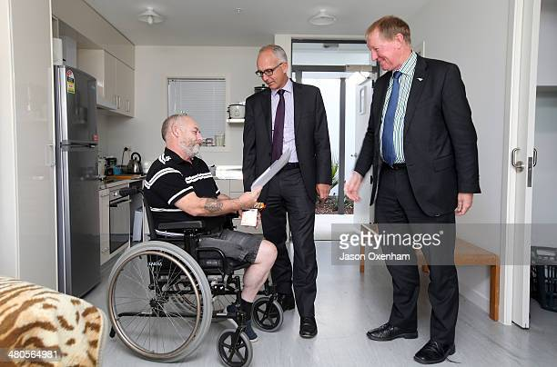 Dr Nick Smith Minister of Housing and Glen Sowry Housing New Zealand CEO talk with resident Shane Kirkus in his home at the opening of Housing New...