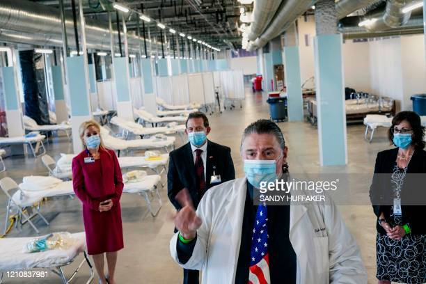 Dr Nick Yphantides speaks to members of the media during a tour of a new Federal Medical Station at Palomar Hospital in Escondido California on April...