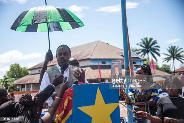 Dr Oly Ilunga Kalenga minister of health of the Democratic Republic of Congo addresses residents at the town all of Mbandaka on May 21 2018 during...