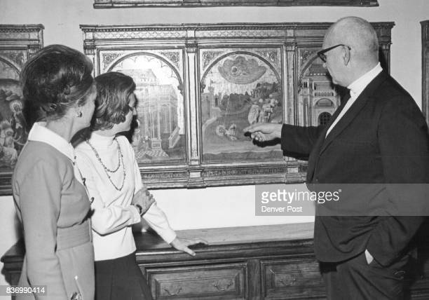 Dr Otto Karl Bach points out details in 15thcentury tempera panel Altarpiece of St Peter and St Paul for museum members left Mrs W Burch Winder and...