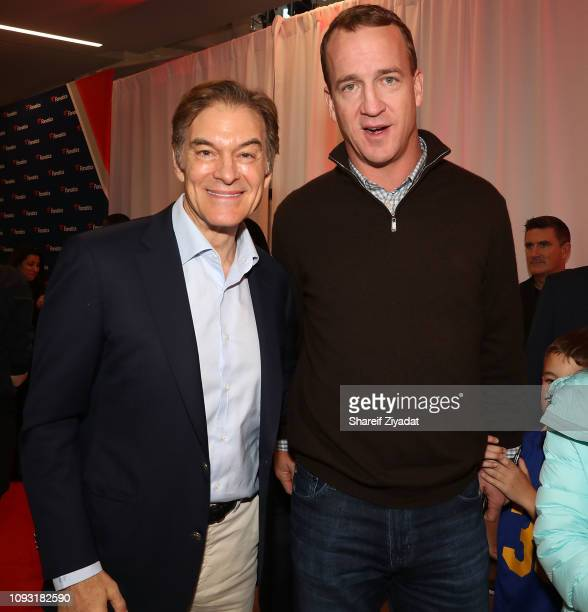 Dr Oz and Peyton Manning attend Fanatics Super Bowl Party at College Football Hall of Fame on February 2 2019 in Atlanta Georgia