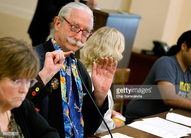 Dr Patch Adams founder of the Gesundheit Institute checks his microphone during a health care reform discussion on Capitol Hill July 28 2009 in...