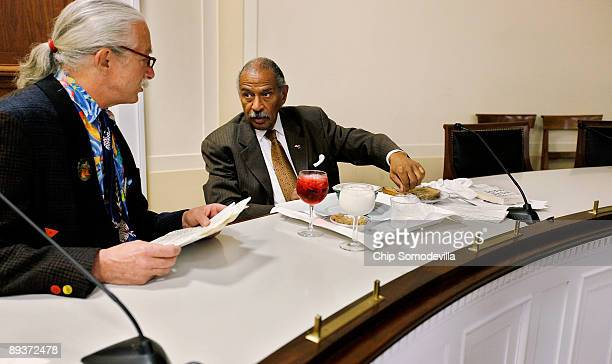 Dr Patch Adams founder of the Gesundheit Institute talks with House Judiciary Committee Chairman John Conyers as he eats breakfast before a health...