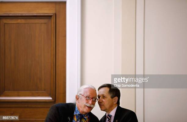 Dr Patch Adams founder of the Gesundheit Institute talks with Rep Dennis Kucinich during during a health care reform panel discussion with House...