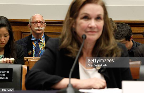 Dr Patch Adams listens to Elizabeth Edwards a senior fellow at the Center for American Progerss Action Fund and wife of former Sen John Edwards...