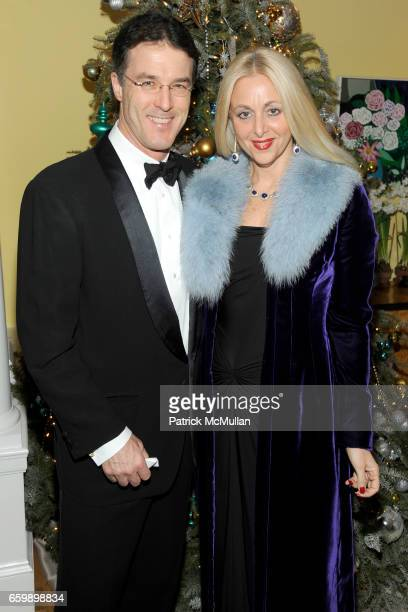 Dr Patrick Stubgen and Dana Hammond Stubgen attend JOHN DEMSEY Holiday Party at Private Residence on December 15 2009 in New York City