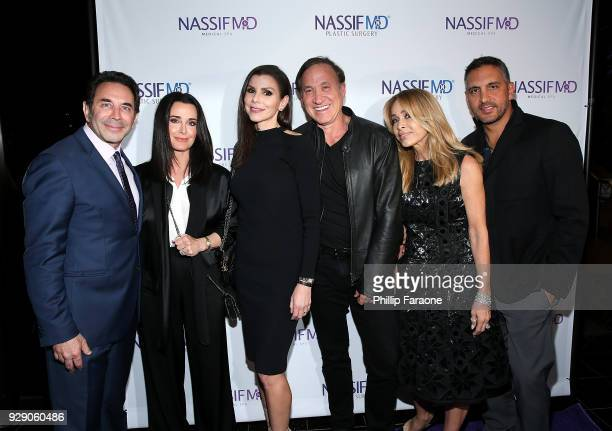 Dr Paul Nassif Kyle Richards Heather Dubrow Terry Dubrow Faye Resnick and Mauricio Umansky arrive for Dr Paul Nassif's unveiling of his new medical...