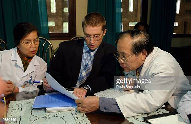 Dr Peter Horby of World Health Organization a medical epidemiologist goes over statistics with Vietnamese medical staff on the Bird Flu at the...