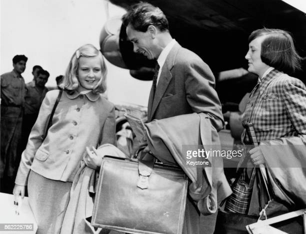 Dr Petter Lindstrom, the first husband of actress Ingrid Bergman, arrives at Los Angeles Airport with their daughter Pia Lindstrom and his friend Kay...