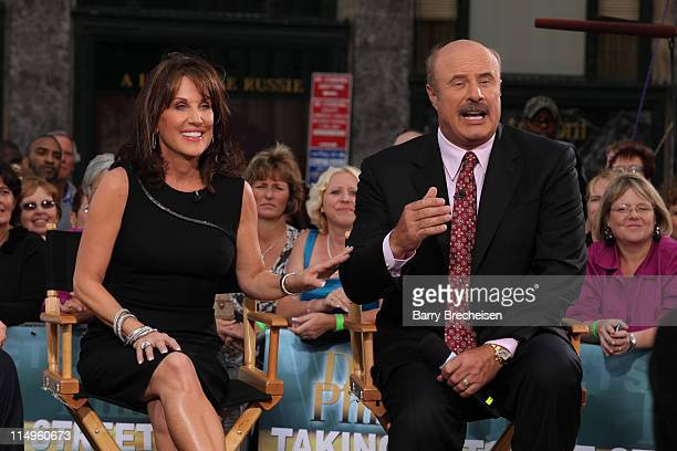 Dr Phil and wife Robin McGraw promote the launch of the eighth season of his television show 'Dr Phil' on CBS at GM Plaza on September 14 2009 in New...
