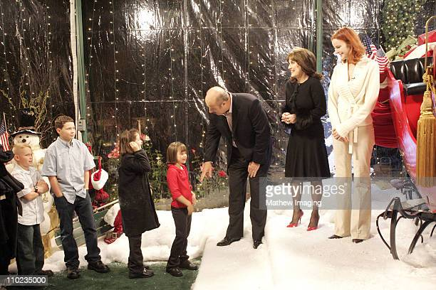 Dr Phil McGraw and his wife Robin along with Marcia Cross from 'Desperate Housewives' greet children who's parents are serving in Iraq The McGraws...