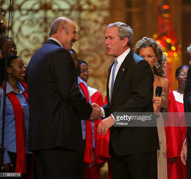 Dr Phil McGraw and President George W Bush during TNT's 'Christmas in Washington 2004' Show and Audience at National Building Museum in Washington DC...
