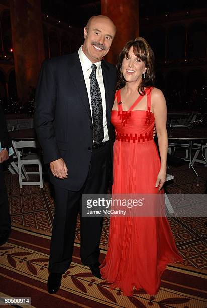 Dr Phil McGraw and Robin McGraw pose backstage during TNT's Christmas in Washington 2007 at the National Building Museum on December 9 2007 in...