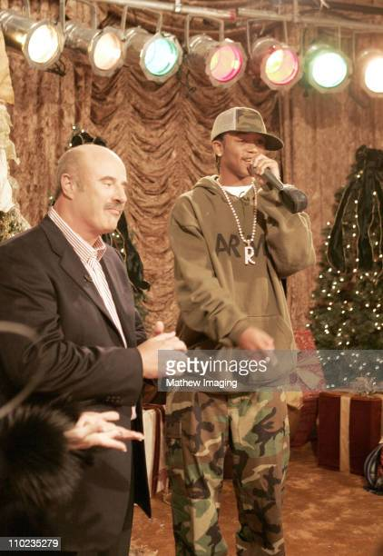 Dr Phil McGraw claps and Lil Romeo raps at a special Christmas party for children whose parents are serving in Iraq The McGraws turned their home...