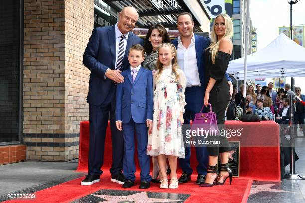 Dr Phil McGraw his wife Robin McGraw his son Jay McGraw and his wife Erica Dahm with their two children London and Avery McGraw attend the ceremony...