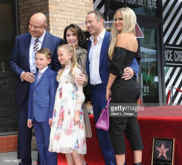 Dr Phil McGraw poses with his family wife Robin McGraw son Jay McGraw daughterinlaw Erica Dahm and grandchildren London Philip McGraw and Avery...