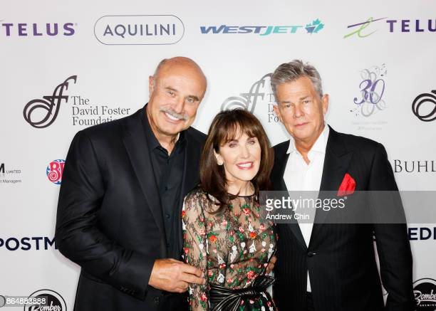Dr Phil McGraw Robin McGraw and David Foster attend the David Foster Foundation Gala at Rogers Arena on October 21 2017 in Vancouver Canada