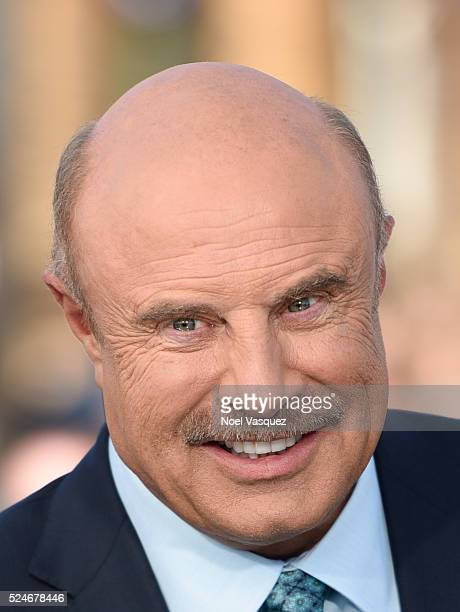 Dr Phil visits 'Extra' at Universal Studios Hollywood on April 26 2016 in Universal City California