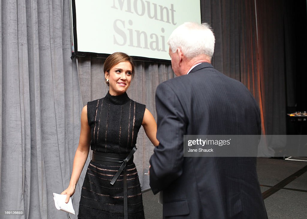 Dr. Philip J. Landrigan thanks Jessica Alba at Champion For Children Award Ceremony Honoring Jessica Alba at Hyatt Regency Greenwich on May 20, 2013 in Greenwich, Connecticut.