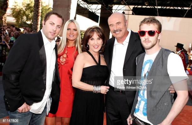 ACCESS*** Dr Phil's family son Jay McGraw Erica Dahm wife Robin McGraw Dr Phil and son Jordan McGraw arrives at the 43rd annual Academy Of Country...