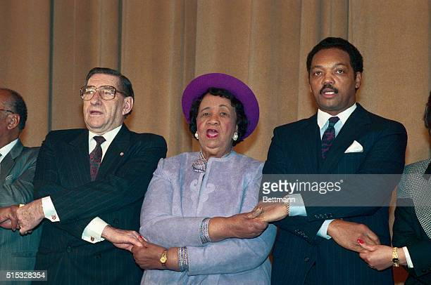 Dr Piet Koornnor the South African ambassador to the US joins hands with Dr Dorothy Height President of the National Council of Negro Women and Rev...