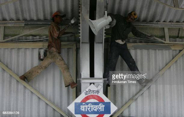 Dr Prakash Vora Occupation Painting Painters Laddoo Yadav and Bharat Kumar Mishra paint at the new Borivali platform to be inaugurated by Laloo...