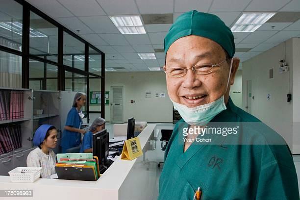 Dr Preecha Tiewtranon just outside the operating theatre at the Bangkok Nursing Home hospital in Thailand's capital Bangkok A Thai national Dr...