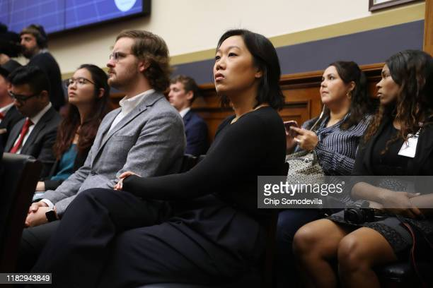 Dr Priscilla Chan wife of Facebook cofounder and CEO Mark Zuckerberg listens to her husband testify before the House Financial Services Committee in...