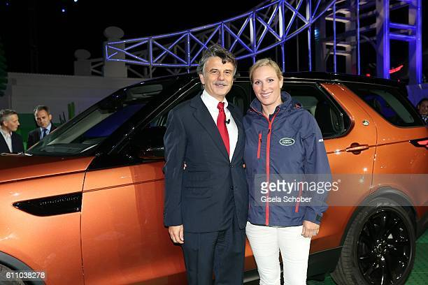 Dr Ralf Speth CEO Jaguar Land Rover and Zara Phillips during the world premiere of the allnew Land Rover Discovery at Packington Hall park on...