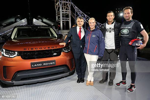 Dr Ralf Speth CEO Jaguar Land Rover Zara Phillips Bear Grylls and sailor Sir Ben Ainslie during the world premiere of the allnew Land Rover Discovery...