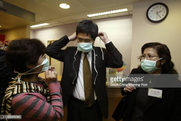 Dr Raymond Chen Chief Executive of the Alice Ho Miu Ling Nethersole Hospital wearing a mask at the emergency unit with DAB members Peggy Wong and Eva...