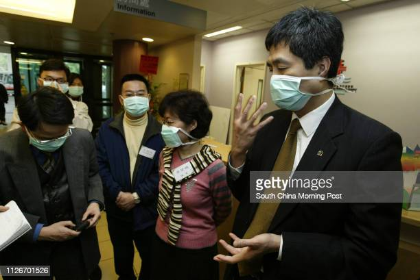 Dr Raymond Chen Chief Executive of the Alice Ho Miu Ling Nethersole Hospital wearing a mask at the emergency unit with DAB members at the hospital 19...