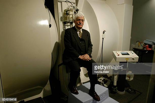 Dr Raymond Damadian poses with an MRI machine at his Long Island office A Biblebelieving Christian this inventor is convinced of the scientific truth...