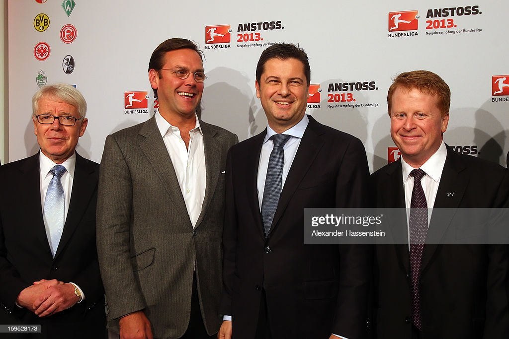 Dr. Reinhard Rauball, President of the DFL, James Murdoch, CEO News Corporation Europe and Asia, Christian Seifert, chairman of business for the DFL and Brian Sullivan, chairman of SKY Germany, (l-r) pose during the DFL new year's reception at the Thurn und Taxis Palais on January 15, 2013 in Frankfurt am Main, Germany.