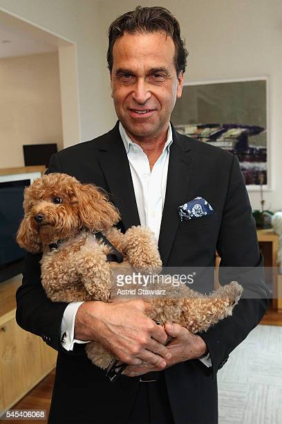 Dr Richard Firshein and dog Freddy attend a cocktail party celebrating director Joe Berlinger's 'Tony Robbins I Am Not Your Guru' hosted by DuJour...
