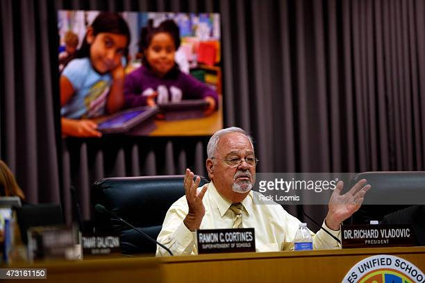 Dr Richard Vladovic president of the LAUSD school board talks with community members during their session on May 12 2015 in Los Angeles California...