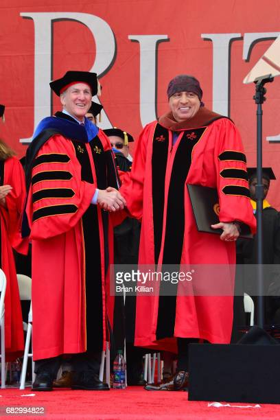 Dr. Robert Barchi awards Steven Van Zandt with an Honorary Doctor of Fine Arts degree during the Rutgers University Commencement at High Point...