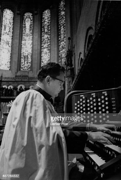 Dr Robert Finster At St John's Pipe Organ With the beautiful aspe windows in the background Dr Finster sits at the pipe organ in sancutary for three...