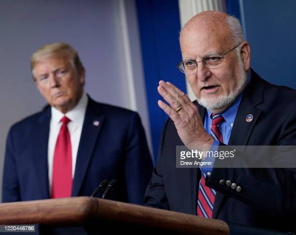 Dr. Robert Redfield, Director of the Centers for Disease Control and Prevention speaks while U.S. President Donald Trump listens during the daily...