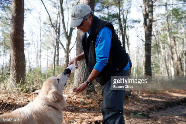 Dr Roger Kligler stops to give his dog Bodie a drink of water as they walk the woods in Falmouth MA on Feb 25 2017 Dr Roger Kligler filed a state...