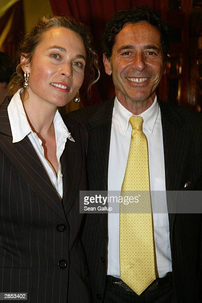 Dr Roger Schawinski head of German television station SAT1 and his wife Gabriella Sontheim attend the SAT1 new year's party January 8 2003 in Berlin...